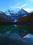 The Xiannairi Holy Mountain and Zhuoma La Lake, Yading, daocheng Stock Images
