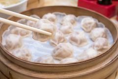 Xiao long bao soup dumpling buns with chopsticks in restaurant Traditional Chinese food in Taipei Taiwan. Xiao long bao soup dumpling buns with chopsticks in stock photos