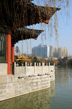 Xiao Yao Pavilion and Hefei City view. The corner of Xiao Yao pavilion on the edge of the lake at Xiaoyaojin Park with high rise apartment buildings of Hefei stock image