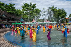 Xiaoganlanba Xishuangbanna Dai Park Plaza splash splashing Carnival. Songkran comes from India, with the influence of Buddhism in the Dai region deepened royalty free stock photo