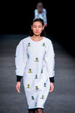 Xiaomeng Huang (model) walks the runway for the Page collection at the 080 Barcelona. BARCELONA - FEB 4: Xiaomeng Huang (model) walks the runway for the Page royalty free stock photos