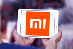 Xiaomi electronics company logo. Logo of electronics company Xiaomi on samsung tablet . Xiaomi is a privately owned Chinese electronics company headquartered in stock photography