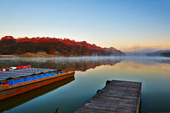 Xiaoqing lake sunrise and boat Royalty Free Stock Images