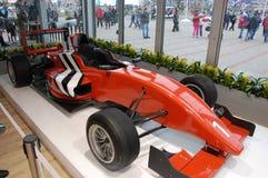 Красная гоночная машина на XII Олимпийских Играх Сочи зимы Стоковое Изображение RF