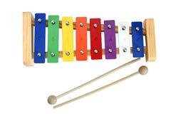Xilófono Metallophone para los cabritos con los palillos Foto de archivo libre de regalías