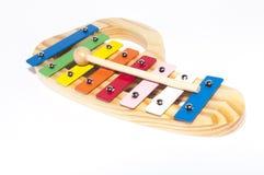 Xilofone de madeira colorido com a vara isolada Fotos de Stock Royalty Free