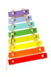 Xilofone de madeira do brinquedo isolado no branco Fotos de Stock
