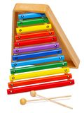Xilofone tornando-se do brinquedo do ` s das crianças Isolado no branco fotografia de stock royalty free