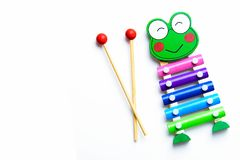 Xilophone music playing. Xilophone toy. Colorful child`s glockenspiel with two wooden mallets, playing Stock Photography