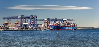 COSCO Shipping at berth in Port Botany, Australia. The Xin Qing Dao container ship belonging to the COSCO Shipping Line docks at Haynes Dock, Port Botany stock photos