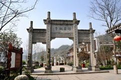 Xin Xing Zhen, China: Ceremonial Gate. An elegant ceremonial entrance gate with bas relief dragons and inscribed Chinese characters welcomes people to the town Stock Photos