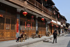 Xin Xing Zhen, China: Sichuan Half-Timbered Houses. Handsome Sichuan style half-timbered wooden houses with balconies and lattice window grills hung with red Stock Image