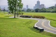Xindian Creek bicycle lanes. The road with the grass and the trees in the park royalty free stock photo
