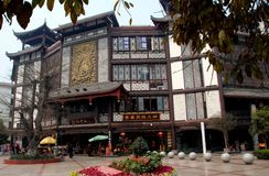 Xindu, China: Chinese Old-Style Buildings. Handsome brown and white old-style buildings featuring intricate wooden latticework and bronze bas relief sculptures Stock Image