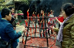 Xindu, China: People Lighting Incense Sticks Stock Photos