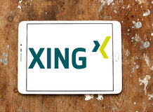 Xing social networking logo. Logo of social networking website xing on samsung tablet on wooden background Stock Photos