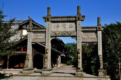 Xing Xing Town, China: Ceremonial Entrance Gate. An imposing ceremonial entrance gate inscribed with Chinese characters leads into the main street of Xing Xing Royalty Free Stock Photography