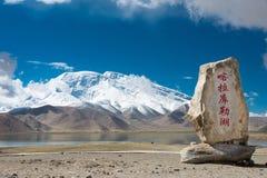 XINJIANG, CHINA - May 21 2015: Karakul Lake Monument at Karakul. Lake. a famous landscape on the Karakoram Highway in Pamir Mountains, Akto County,Kizilsu royalty free stock images