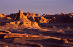 Xinjiang Ghost City at sunset. Because it is located in the outlet, Ghost City Four Seasons wind continued, it will send Guikulanghao sound, hence the name Stock Photography