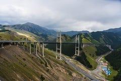 Xinjiang Guozigou highway bridge. Xinjiang, China, is 700 meters long, 200 meters from the bridge deck, steel truss girder structure Guozigou highway bridge Stock Photography