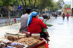 Xinjiang people selling dried fruit Royalty Free Stock Photos