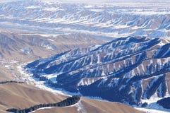 Xinjiang snowfield. Winter scenery  ravines and gullies criss-cross Stock Photos