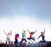 Éxito adolescente Team Jumping Cheerful Concept Fotos de archivo libres de regalías