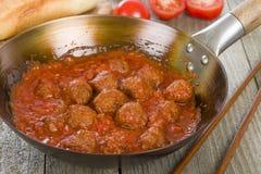 Xiu Mai. Vietnamese spicy pork meatballs in fragrant tomato sauce royalty free stock photos
