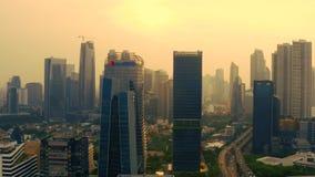 XL Axiata-toren en andere wolkenkrabbers in Djakarta stock video