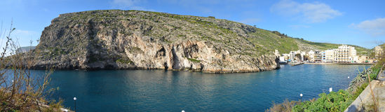 Xlendi Bay - Gozo, Malta. The cliffs and the secluded beach of Xlendi Stock Images