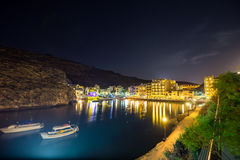 Xlendi, Gozo - Beautiful aerial view over Xlendi Bay by night. Beautiful aerial view over Xlendi Bay by night with restaurants, boats and busy night life on the Stock Images