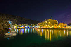Xlendi, Gozo - Beautiful aerial view over Xlendi Bay by night. Beautiful aerial view over Xlendi Bay by night with restaurants, boats and busy night life on the Royalty Free Stock Photos