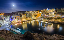 Xlendi, Gozo - Night shot of Malta`s most beautiful town. Night photograph of Malta`s most beautiful mediterranean town with busy night life, restaurants, hotels royalty free stock photography