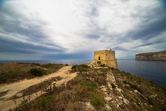 Xlendi Tower on Gozo island, Malta. The ix-Xlendi tower is the oldest free-standing coastal watchtower in Gozo Stock Images