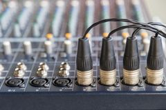 XLR connectors on the audio mixers. The XLR connectors on the audio mixers slider board stock images