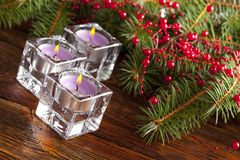 xmas树三个圣诞节蜡烛和分支  库存图片