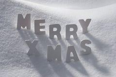 Xmas слова белого рождества веселый на снеге Стоковое фото RF