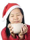 Xmas-14. Beautiful girl in christmas clothes with cup of coffee or drink Royalty Free Stock Image