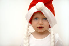 Xmas. Little girl as santa claus Stock Photography