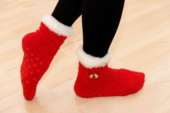 Xmas. Red xmas shoes with female legs Royalty Free Stock Photo