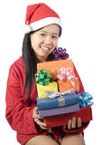 Xmas-4. Beautiful girl in christmas clothes with a gift Stock Photography