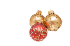 Xmas. Some christmas balls isolated golden and red Stock Image
