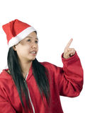 Xmas-8. Beautiful girl in christmas clothes pointing upwards on white background Stock Photo