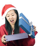 Xmas-9. Beautiful girl in christmas clothes with a gift Royalty Free Stock Photo