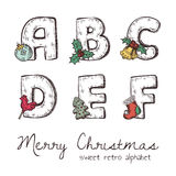Xmas alphabet. Vector retro christmas alphabet with symbols of holiday isolated in white - a, b, c, d, e, f Royalty Free Stock Images