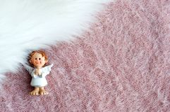 Xmas angel on the fluffy table. A little xmas angel waiting for Christmas time to send good news Stock Photography