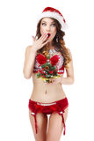 Xmas. Astonished Glamorous Woman in Santa Claus' Costume with Christmas Gift Stock Photos