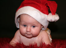 Xmas baby. Sweet baby with a xmas cape royalty free stock photos