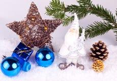 Xmas background. Santa claus figure , gifts ,  xmas balls and xmas tree Stock Images