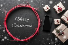 Xmas background with gifts and mobile phone space with christmas snowing message Royalty Free Stock Image